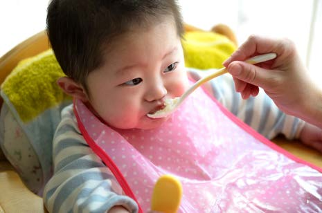 infant eating solid food