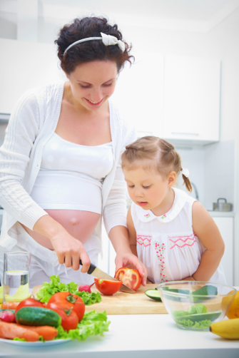 pregnant mother preparing meal