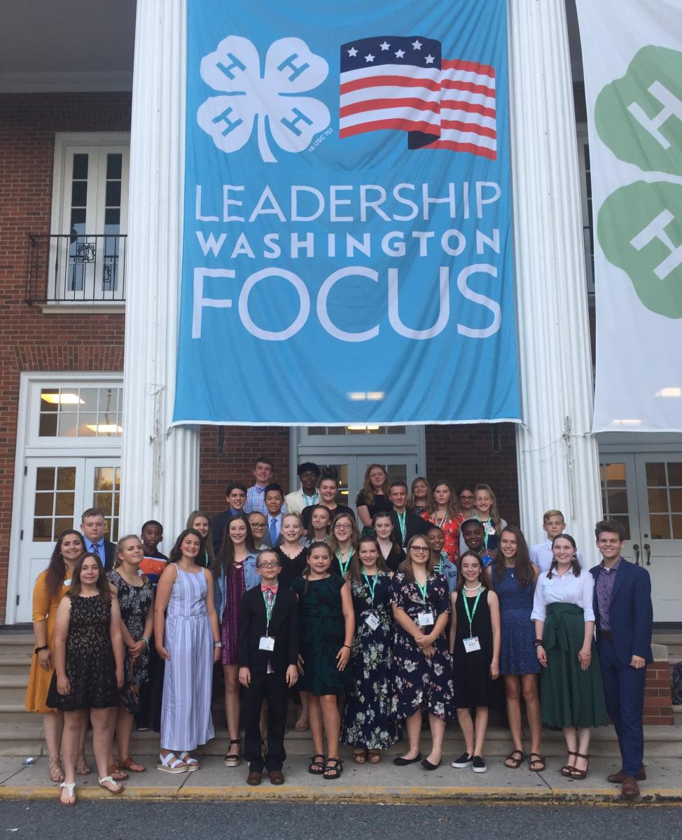 Teens dressed up outside National 4-H building in DC