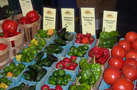Peppers for sale with printed signs and wax crayon prices