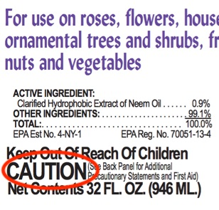 Close up of pesticide label with CAUTION circled