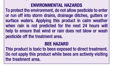 Close up of purple label with hazard information for bees and environment
