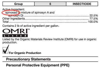Close up of pesticide label with spinosad circled in red