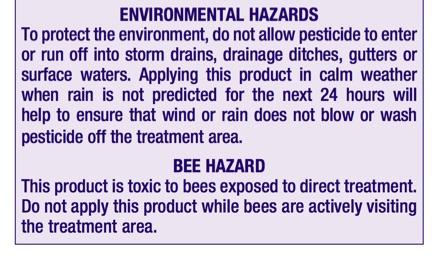Purple hazard label on pesticide bottle