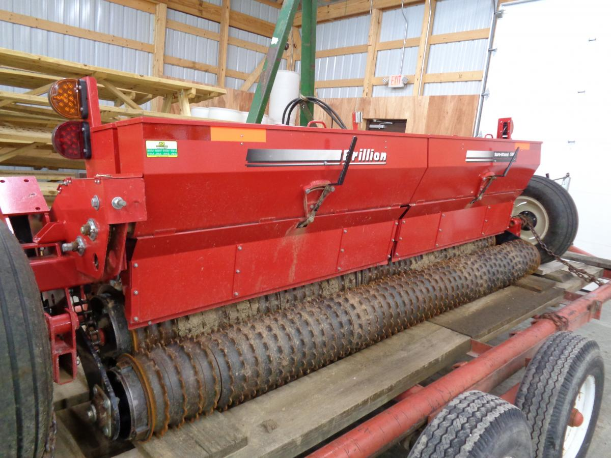 photo of a no-till drill on a flat-bed wagon.