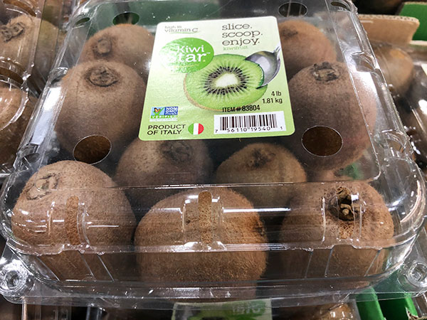 Packaged container of brown fuzzy kiwifruit as sold at a grocery store.