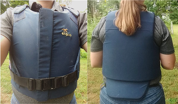 A front and back view of a person wearing a secured blue padded vest.