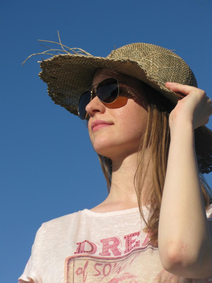 girl wearing sun-safe hat and sunglasses