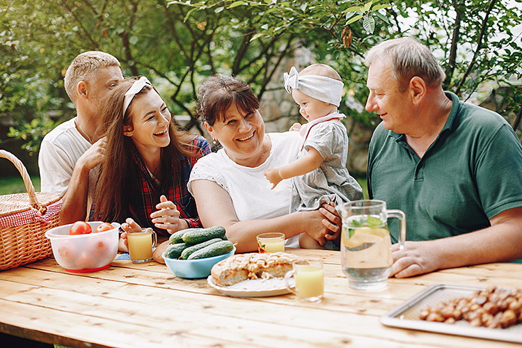 And extended family with grandparents enjoy a meal with their grandchild and her parents.