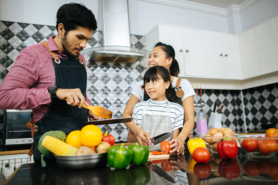 Family fixing a meal using CSA vegetables