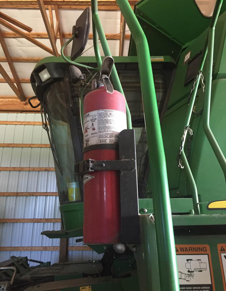 Portable fire extinguisher on a tractor