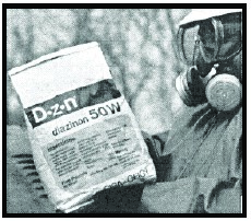 Person with goggles and respirator reading a bag of chemicals to check usage directions