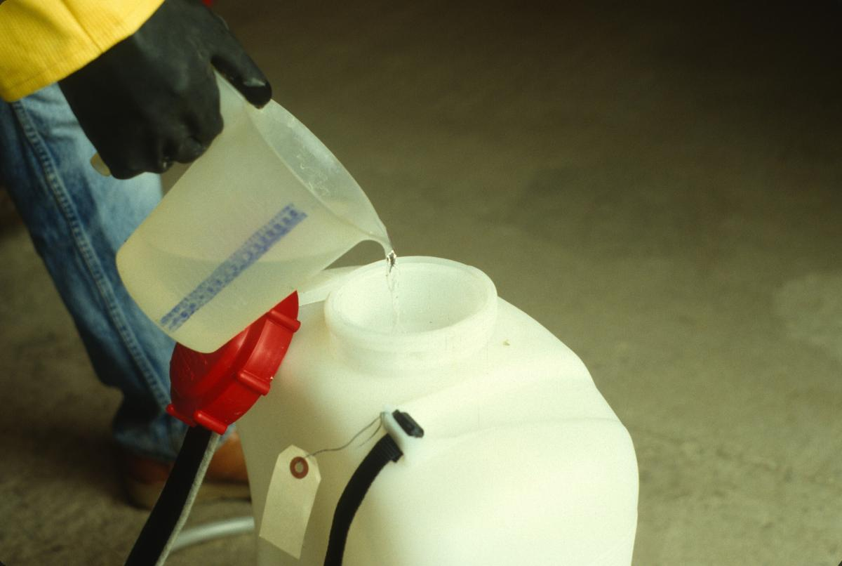 refilling a backpack sprayer