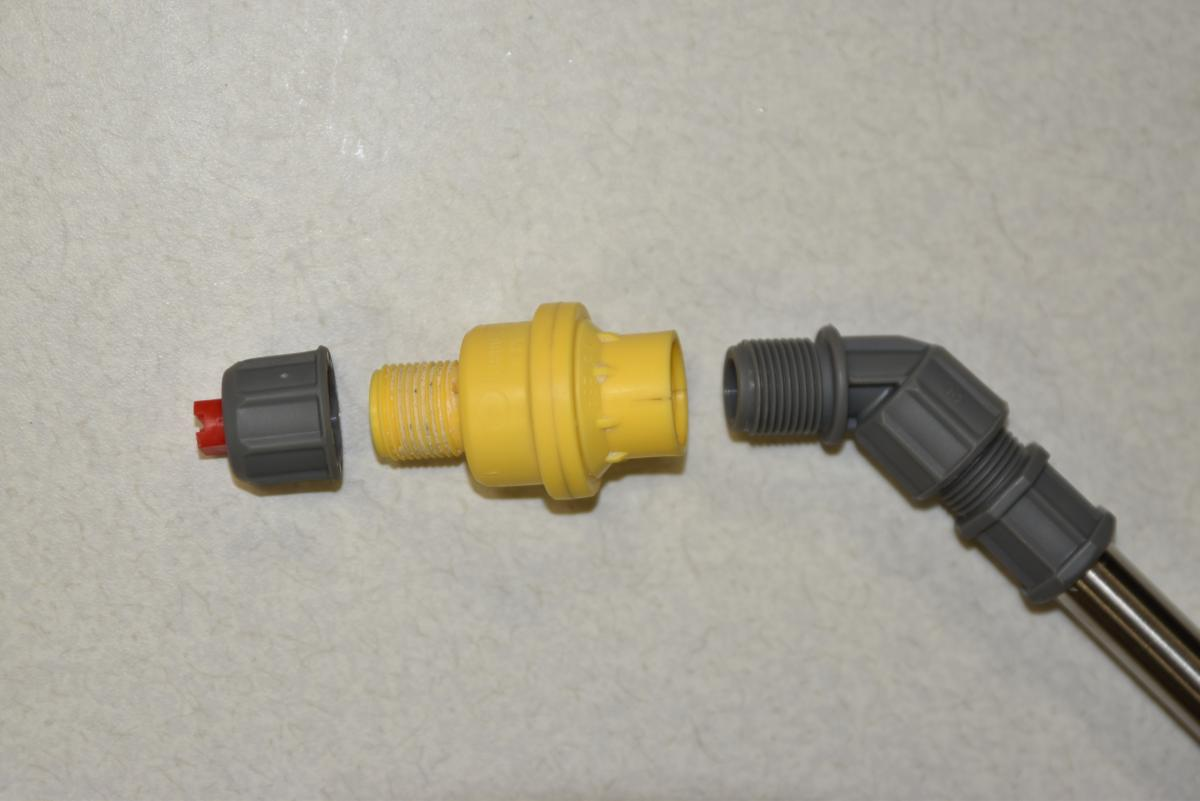 A constant flow valve disconnected to show proper placement