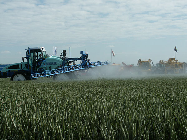 Image showing sprayer in field where spray is floating up