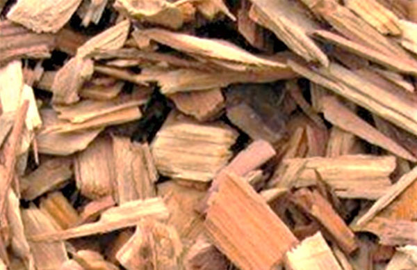 Close up of irregular-sized and shaped wood chips.