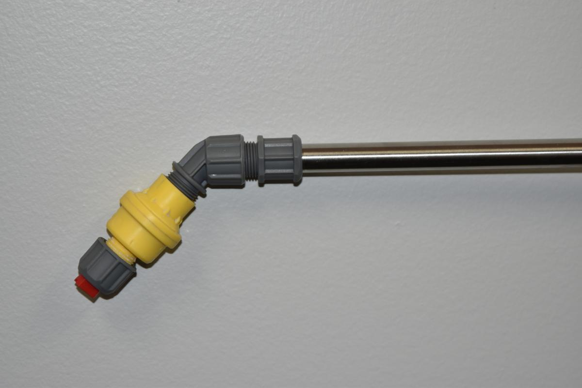 Yellow constant flow valve on a spray wand